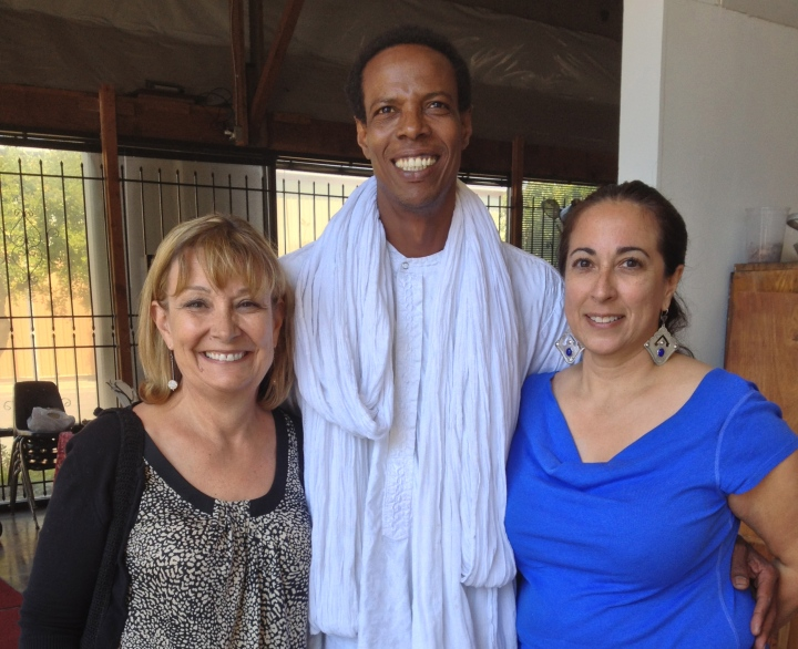 This is Elhadji with me and Sherry. Sherry is wearing some beautiful earrings she bought from Elhadji last year!
